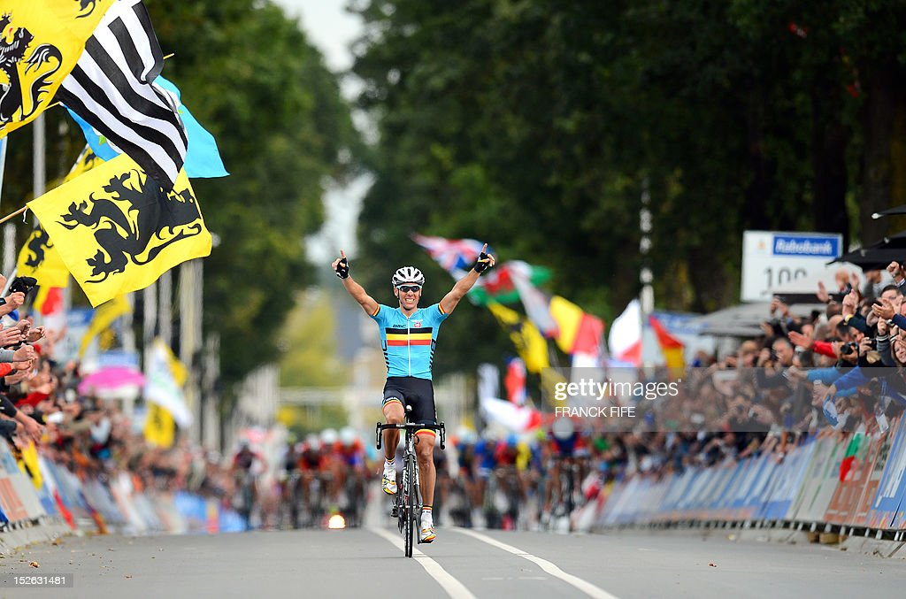 Philippe Gilbert of Belgian celebrates his victory as he crosses the finish line at the Men's Elite Race at the UCI Road World Championships on September 23, 2012 in Valkenburg. Gilbert won the race ahead of Edvald Boasson Hagen of Norway and Alejandro Valverde of Spain. AFP PHOTO / FRANCK FIFE
