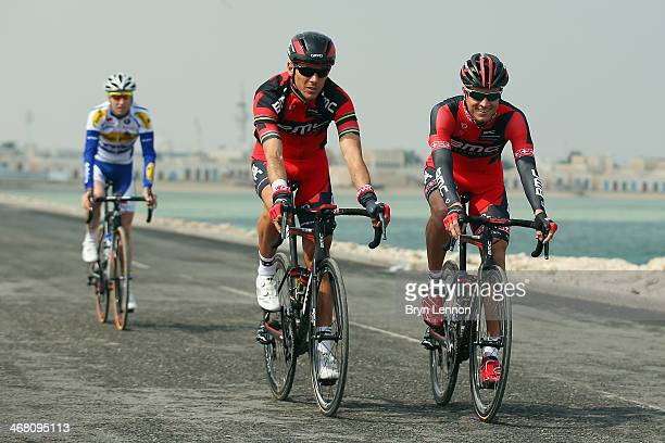 Philippe Gilbert of Belgium and the BMC Racing Team warms up alongside team mate Martin Kohler of Switzerland at the start of stage one of the Tour...