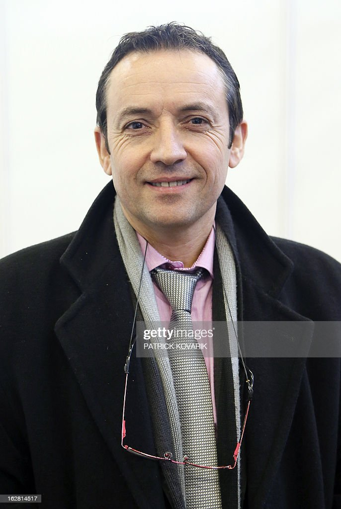 Philippe Huet, cows exporter, poses at the Paris International Agri-business Show (SIMA), which is part of the yearly International Agriculture Fair of Paris, on February 24, 2013, in Villepinte, a Paris suburb. The events runs from February 23 to March 3, 2013.