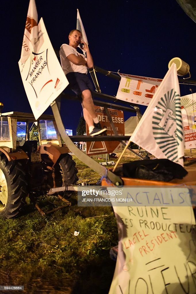 Philippe Jehan president the FDSEA Mayenne a regional federation of farmer union speaks to milk producers outside the Lactalis group headquarters in...