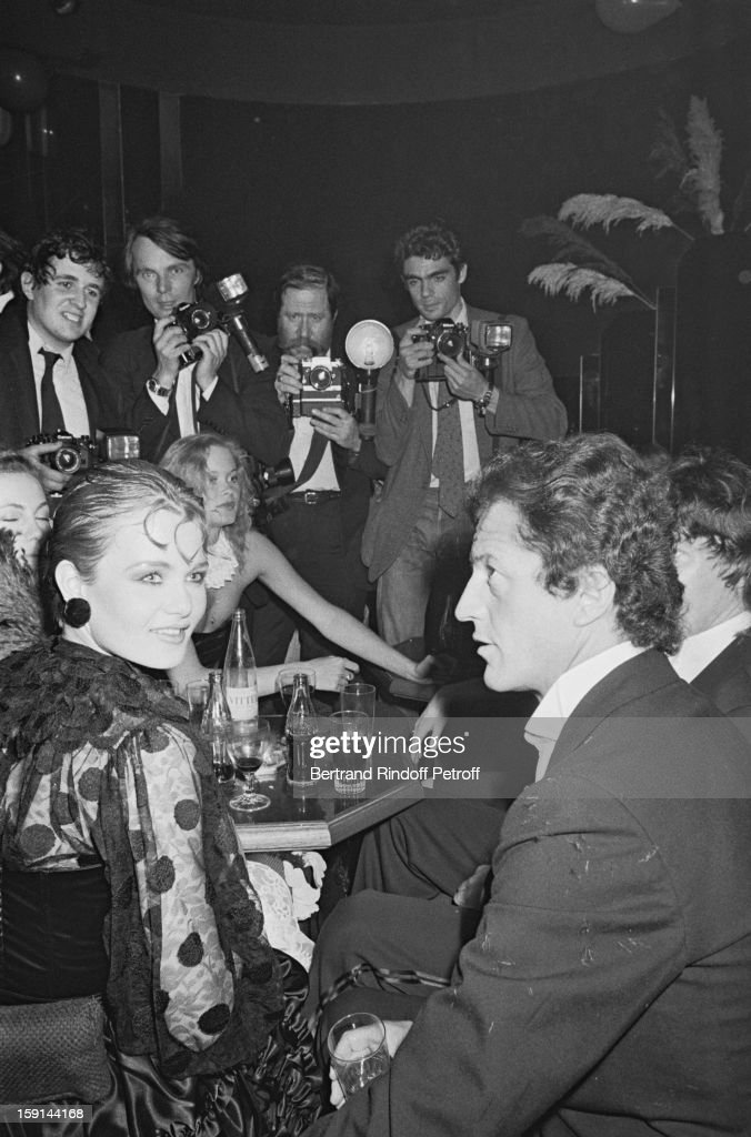 Philippe Junot and a friend with photographers Francis Apesteguy and Michel Dufour attend a party at the Apocalypse night club in Paris
