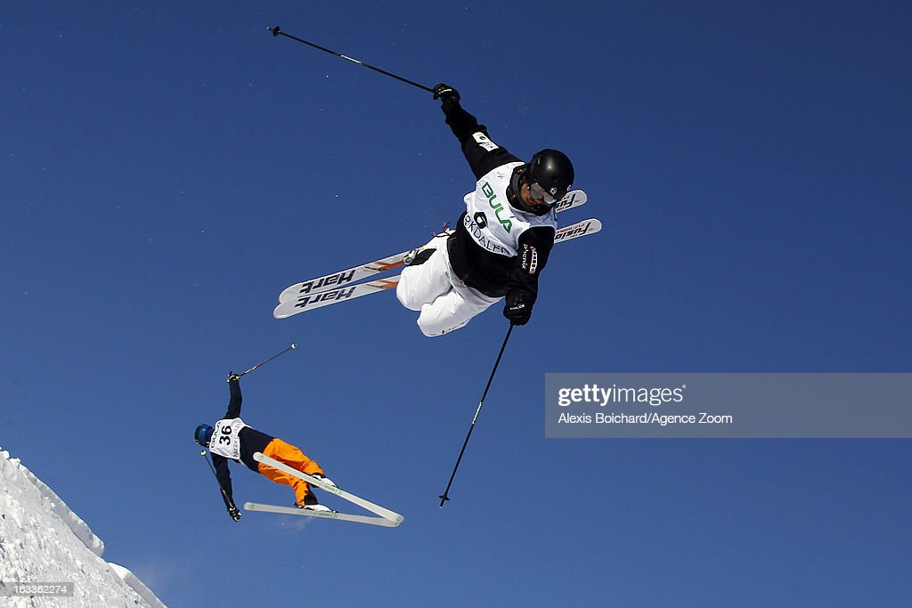 Philippe Marquis (R) of Canada and Ville Miettunen of Finland compete during the FIS Freestyle Ski World Championship Men's and Women's Dual Moguls on March 08, 2013 in Voss, Norway.