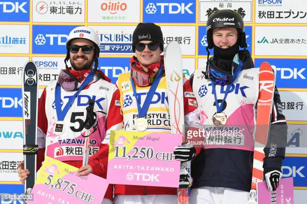 Philippe Marquis of Canada Mikael Kingsbury of Canada Benjamin Cavet of France pose on the podium during 2017 FIS Freestyle Ski World Cup Tazawako In...