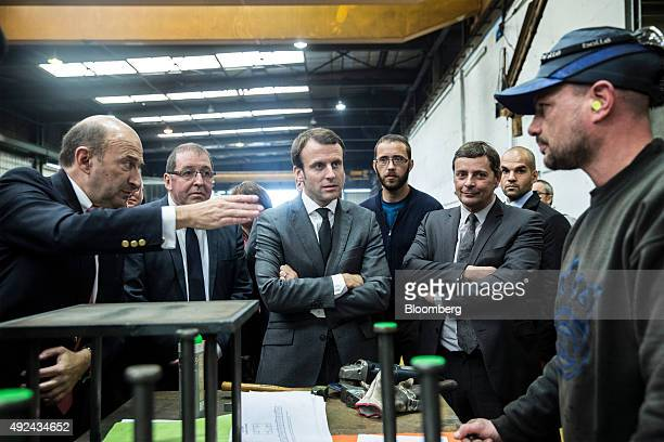 Philippe Matiere chief executive officer of Matiere SAS left gestures as Emmanuel Macron France's economy minister center meets employees at bridge...