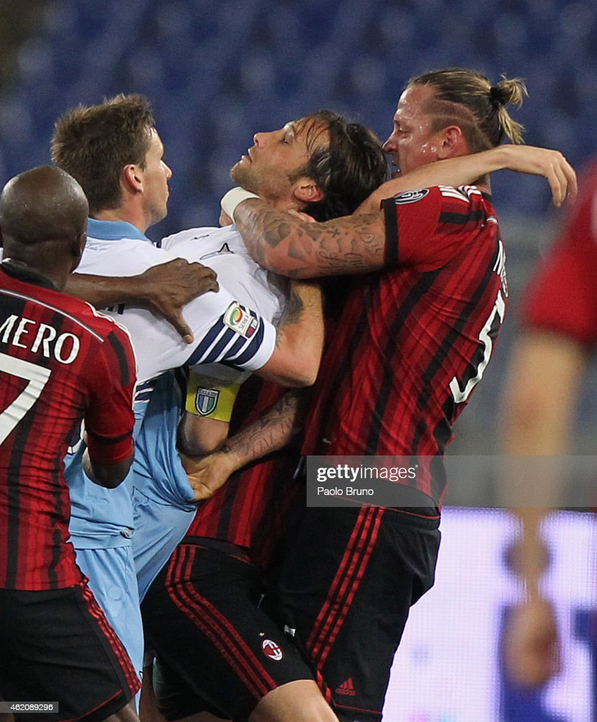 Philippe Mexes #5 of AC Milan and <a gi-track='captionPersonalityLinkClicked' href=/galleries/search?phrase=Stefano+Mauri&family=editorial&specificpeople=676361 ng-click='$event.stopPropagation()'>Stefano Mauri</a> of SS Lazio react during the Serie A match between SS Lazio and AC Milan at Stadio Olimpico on January 24, 2015 in Rome, Italy.