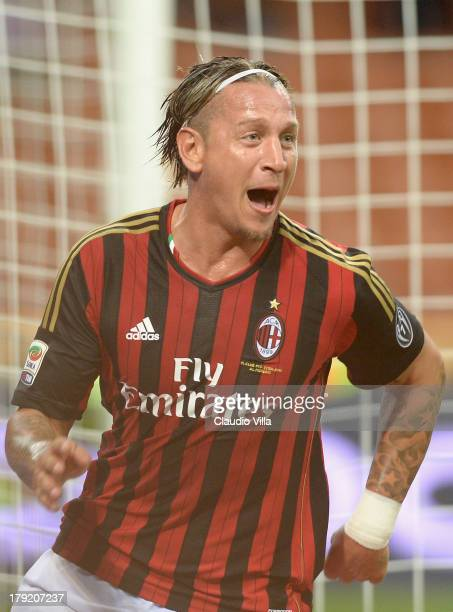 Philippe Mexes of AC Milan celebrates scoring his team's second goal during the Serie A match between AC Milan and Cagliari Calcio at San Siro...