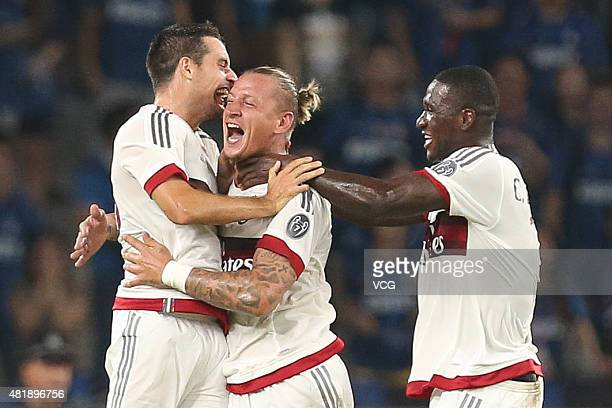 Philippe Mexes of AC Milan celebrates with team mates after scoring his team's first goal during the International Champions Cup match between AC...