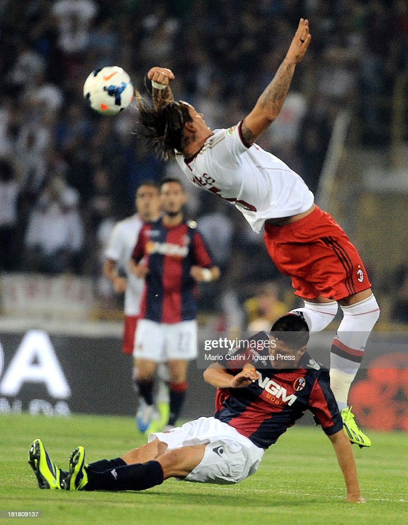 Philippe Mexes # 5 of AC Milan ( R ) competes for the ball with Cristaldo # 99 of Bologna FC ( L ) during the Serie A match between Bologna and AC Milan at Stadio Renato Dall'Ara on September 25, 2013 in Bologna, Italy.
