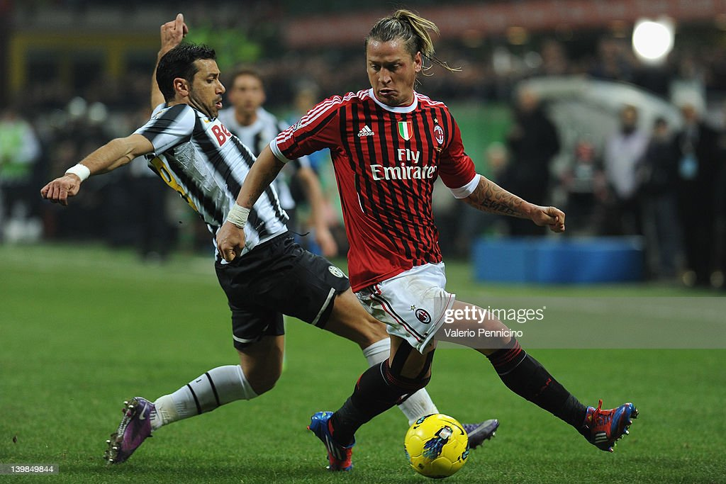 Philippe Mexes (R) of AC Milan in action against Fabio Quagliarella of Juventus FC during the Serie A match between AC Milan and Juventus FC at Stadio Giuseppe Meazza on February 25, 2012 in Milan, Italy.