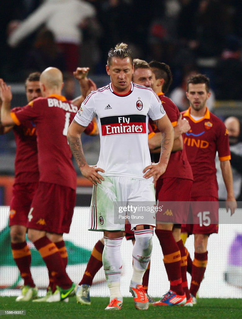 Philippe Mexes of AC Milan shows his dejection during the Serie A match between AS Roma and AC Milan at Stadio Olimpico on December 22, 2012 in Rome, Italy.