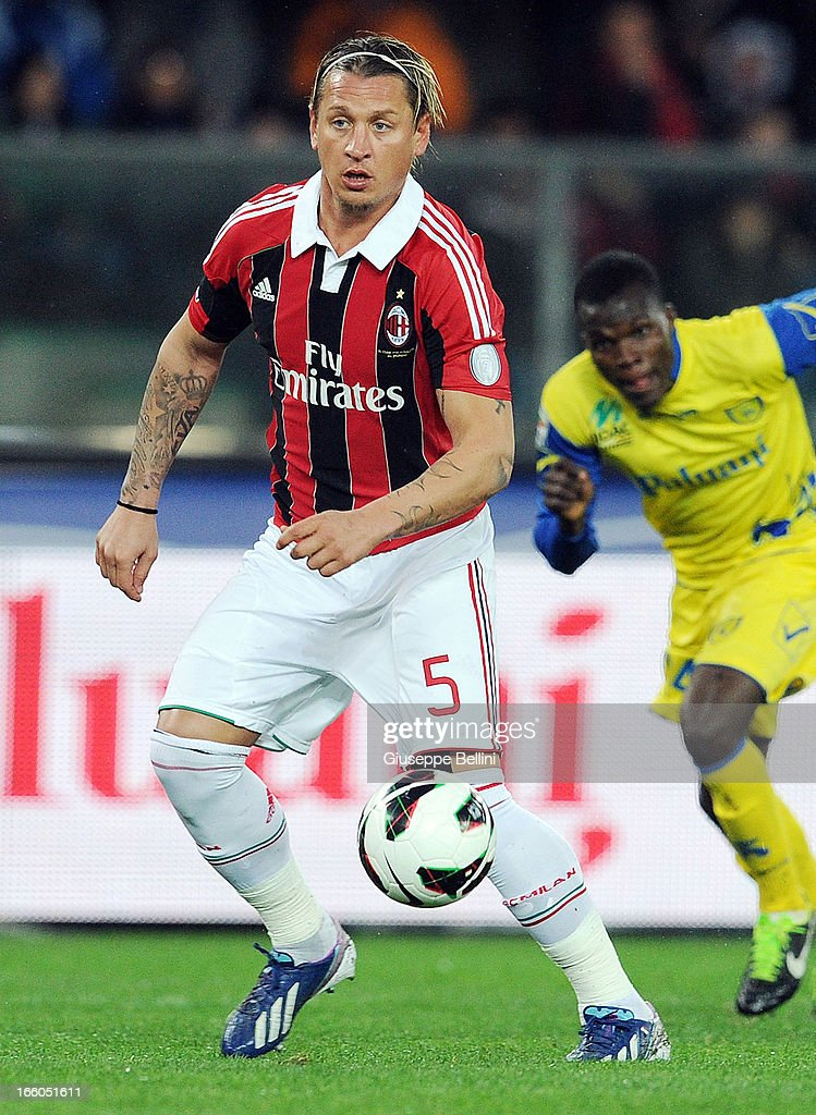Philippe Mexes of Milan in acton during the Serie A match between AC Chievo Verona and AC Milan at Stadio Marc'Antonio Bentegodi on March 30, 2013 in Verona, Italy.