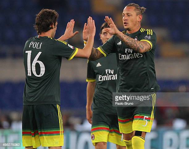 Philippe Mexes with his teammate Andrea Poli of AC Milan celebrates after scoring the team's second goal during the Serie A match between SS Lazio...