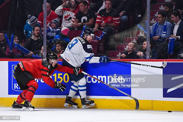 Philippe Myers of Team Canada challenges Janne Kuokkanen of Team Finland near the boards during the IIHF exhibition game at the Bell Centre on...
