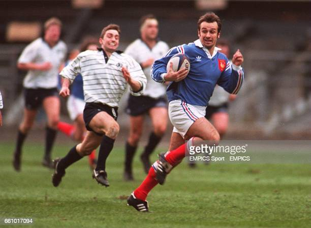Philippe SaintAndre France heads towards the Scottish try line