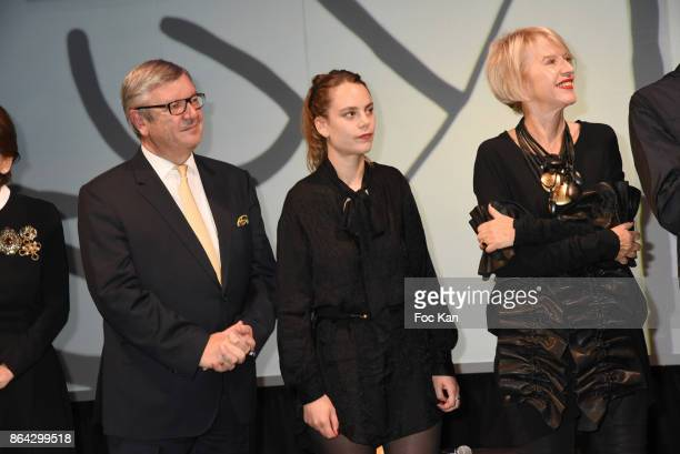 Philippe Savinel Caroline Mesquita and Colette Barbier attend the 'Bal Jaune Elastique 2017' Dinner Party at Palais Brongniart on October 20 2017 in...