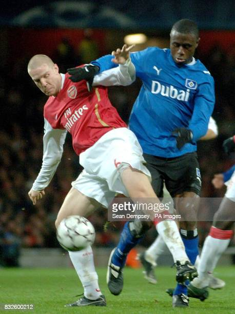 Philippe Senderos Arsenal and Boubacar Sanogo Hamburg battle for the ball during the UEFA Champions League Group G match at the Emirates Stadium