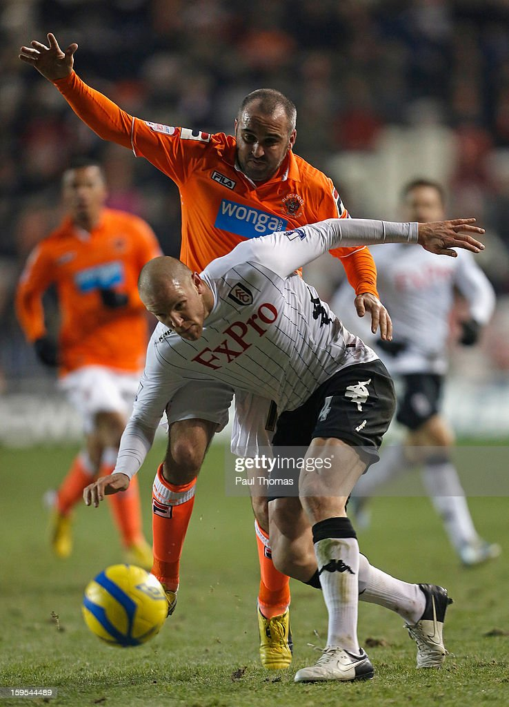 <a gi-track='captionPersonalityLinkClicked' href=/galleries/search?phrase=Philippe+Senderos&family=editorial&specificpeople=221471 ng-click='$event.stopPropagation()'>Philippe Senderos</a> of Fulham competes with Gary Taylor-Fletcher of Blackpool during the FA Cup with Budweiser Third Round Replay match between Blackpool and Fulham at Bloomfield Road on January 15, 2013 in Blackpool, England.
