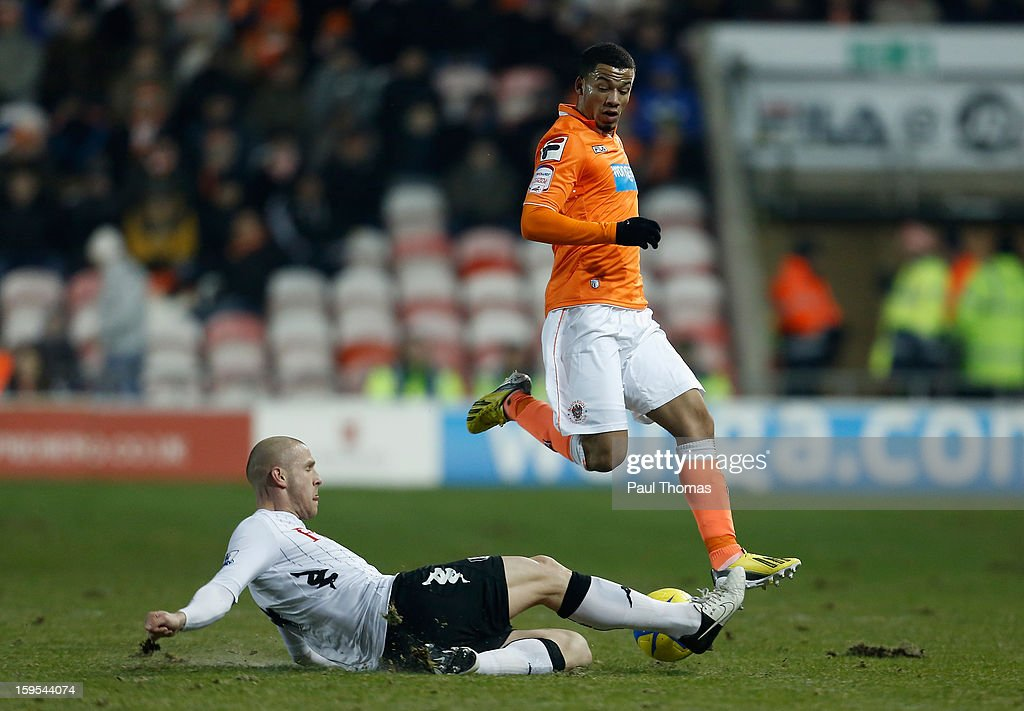 <a gi-track='captionPersonalityLinkClicked' href=/galleries/search?phrase=Philippe+Senderos&family=editorial&specificpeople=221471 ng-click='$event.stopPropagation()'>Philippe Senderos</a> of Fulham tackles Nathan Eccleston of Blackpool during the FA Cup with Budweiser Third Round Replay match between Blackpool and Fulham at Bloomfield Road on January 15, 2013 in Blackpool, England.