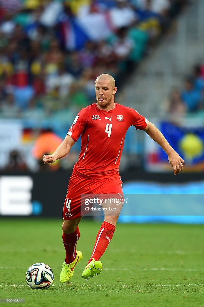 <a gi-track='captionPersonalityLinkClicked' href=/galleries/search?phrase=Philippe+Senderos&family=editorial&specificpeople=221471 ng-click='$event.stopPropagation()'>Philippe Senderos</a> of Switzerland controls the ball during the 2014 FIFA World Cup Brazil Group E match between Switzerland and France at Arena Fonte Nova on June 20, 2014 in Salvador, Brazil.