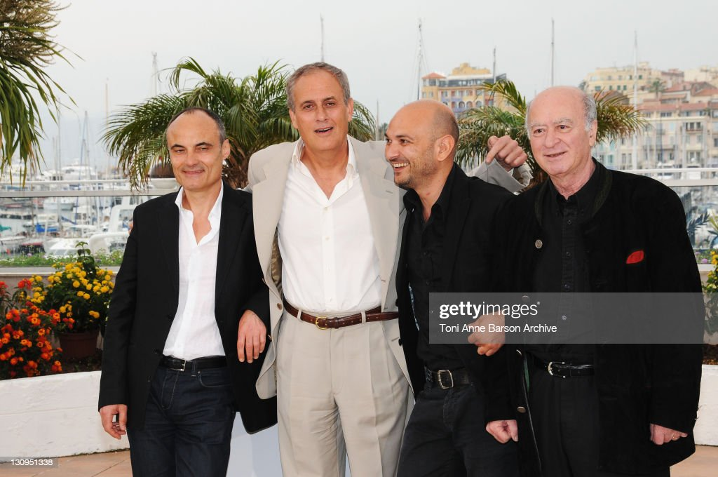 <a gi-track='captionPersonalityLinkClicked' href=/galleries/search?phrase=Philippe+Val&family=editorial&specificpeople=831271 ng-click='$event.stopPropagation()'>Philippe Val</a>, Daniel Leconte, director, Richard Malka and artist <a gi-track='captionPersonalityLinkClicked' href=/galleries/search?phrase=Georges+Wolinski&family=editorial&specificpeople=2077652 ng-click='$event.stopPropagation()'>Georges Wolinski</a> attend the C'est Dur D'etre Aime Par Des Cons Photocall at the Palais des Festivals during the 61st Cannes International Film Festival on May 16, 2008 in Cannes, France.