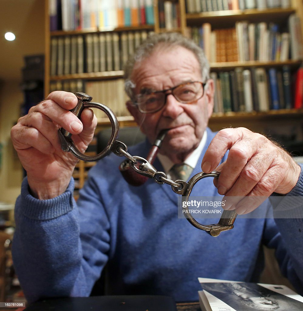MAKRIS Philippe Zoummeroff, a former manufacturer committed in the social reinsertion of inmates and collector of items connected with justice holds handcuffs whose once belonged to Vidocq (1775-1857), the founder and first director of the crime-detection Surete Nationale on February 5, 2013 in Neuilly-sur-Seine, Paris suburb. AFP PHOTO / PATRICK KOVARIK