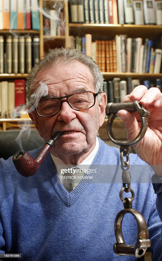 MAKRIS Philippe Zoummeroff, a former manufacturer committed in the social reinsertion of inmates and collector of items connected with justice holds handcuffs whose once belonged to Vidocq (1775-1857), the founder and first director of the crime-detection Surete Nationale on February 5, 2013 in Neuilly-sur-Seine, Paris suburb.
