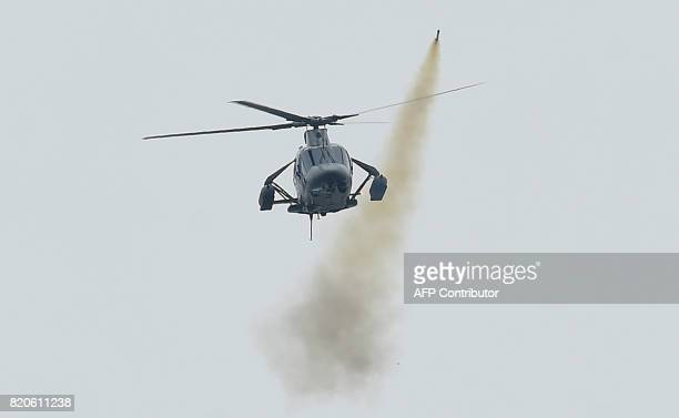 Philippine Air Force attack helicopter fires a rocket at Muslim militant positions at the frontline in Marawi on the southern island of Mindanao on...