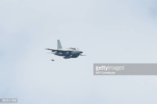 A Philippine airforece F50 fighter jet drops a bomb on Muslim militants' position during an aerial bombing in Marawi on June 24 one month after the...
