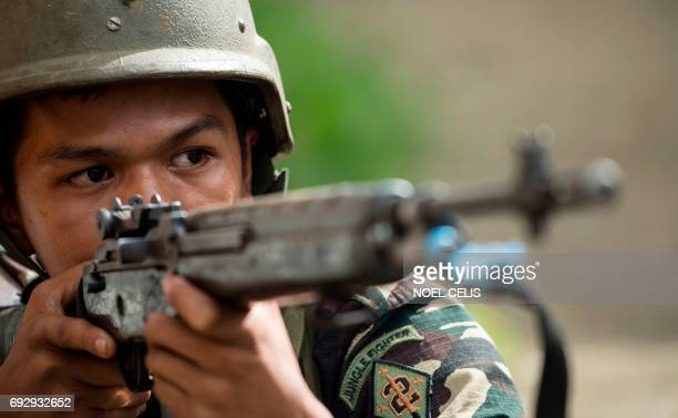 A Philippine Army Scout Ranger aims his weapon during a mission to flush out Islamist militant snipers in Marawi on the southern island of Mindanao...
