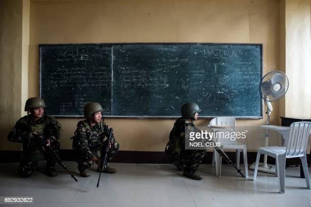 TOPSHOT Philippine Army Scout Rangers crouch in a classroom during a mission to flush out Islamist militant snipers in Marawi on the southern island...
