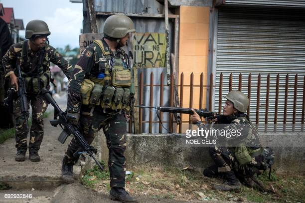 Philippine Army Scout Rangers move positions during a mission to flush out Islamist militant snipers in Marawi on the southern island of Mindanao on...