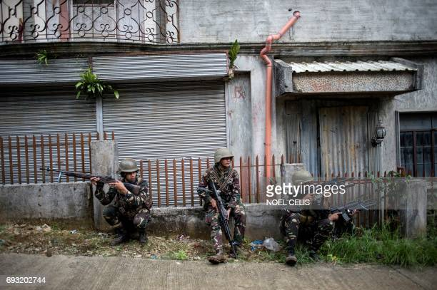 TOPSHOT Philippine Army Scout Rangers take positions during a mission to flush out Islamist militant snipers in Marawi on the southern island of...