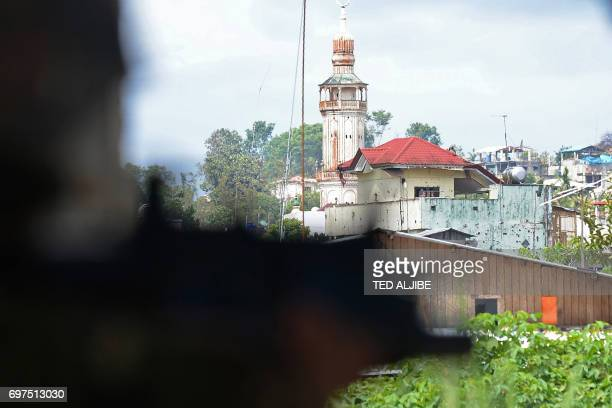 A Philippine Army trooper scans the horizon for sniper fire from Islamist militants near the frontline in Marawi on the southern island of Mindanao...