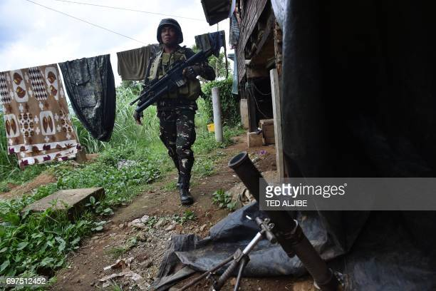 Philippine Army trooper walks past a mortar placement in one of the bases near the frontline in Marawi on the southern island of Mindanao on June 19...