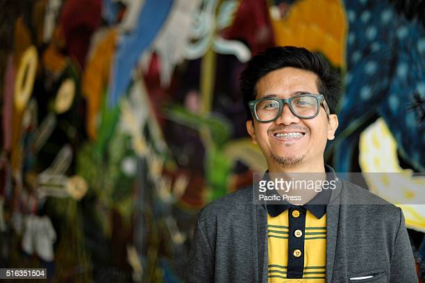 ISLAND SYDNEY NSW AUSTRALIA Philippine artist Rodel Tapaya poses with his artwork at the Art Gallery of New South Wales Embassy of Spirits during the...