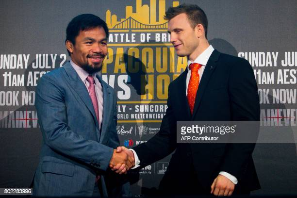 Philippine boxer Manny Pacquiao and Australian challenger Jeff Horn shake hands after a press conference to promote their upcoming WBO welterweight...