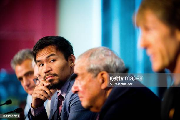 Philippine boxer Manny Pacquiao and boxing promoter Bob Arum attend a press conference to promote Pacquiao's upcoming WBO Welterweight title fight...