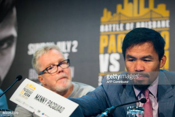 Philippine boxer Manny Pacquiao and trainer Freddie Roach attend a press conference to promote Pacquiao's WBO Welterweight title fight against...