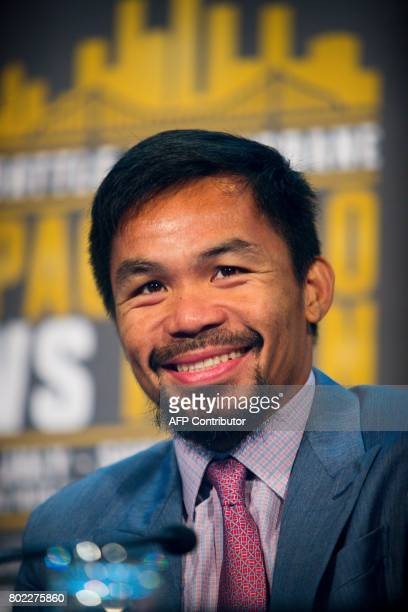 Philippine boxer Manny Pacquiao smiles during a press conference to promote his upcoming WBO welterweight boxing title fight against Australian...