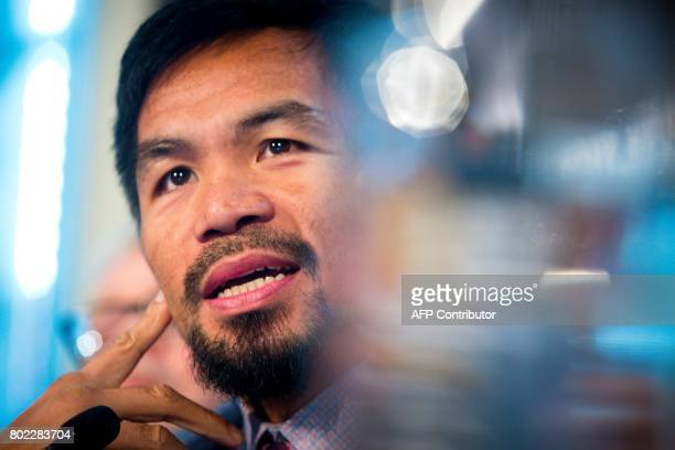 Philippine boxer Manny Pacquiao speaks during a press conference to promote his upcoming WBO welterweight boxing title fight against Australian...