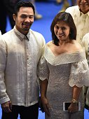 Philippine boxing icon and now senator Manny Pacquiao poses for photos with Vicepresident Leni Robredo as they arrive to attend the State of the...