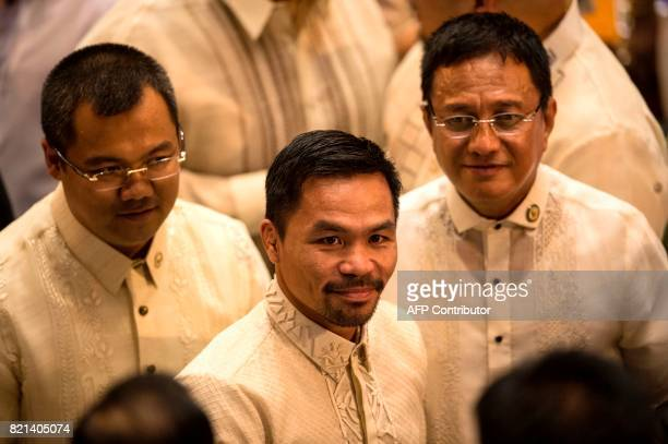 Philippine boxing icon and Senator Manny Pacquiao arrives at the House of Representatives in Manila on July 24 to attend Philippine President Rodrigo...