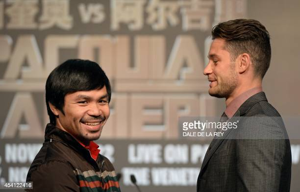 Philippine boxing icon Manny Pacquiao and Chris Algieri of the US pose for photographs during a prefight press conference in Macau on August 25 2014...