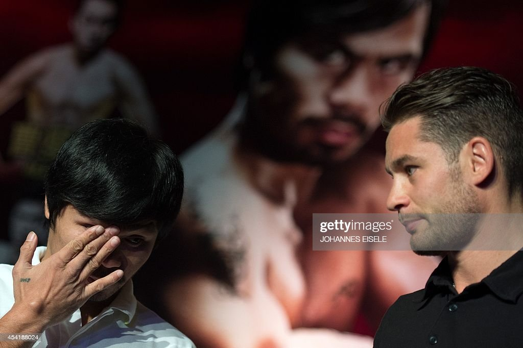 Philippine boxing icon Manny Pacquiao (L) and Chris Algieri (R) of the US take part in a pre-fight press conference in Shanghai on August 26, 2014. Pacquiao will take on Chris Algieri of the US in a World Boxing Organization (WBO) welterweight title fight in Macau on November 23.