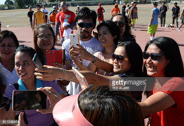 Philippine boxing icon Manny Pacquiao poses for photos with visitors arrives after his training session at the sports complex in General Santos City...