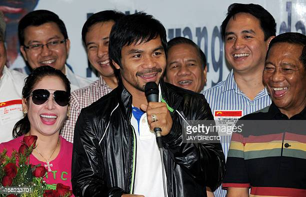 Philippine boxing icon Manny Pacquiao speaks to supporters upon his arrival at Manila's international airport on December 12 2012 on his return from...