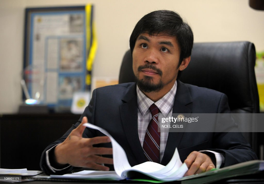 Philippine boxing superstar and congressman Manny Pacquiao works in his office before receiving the Congresional Medal of Distinction at the House of...