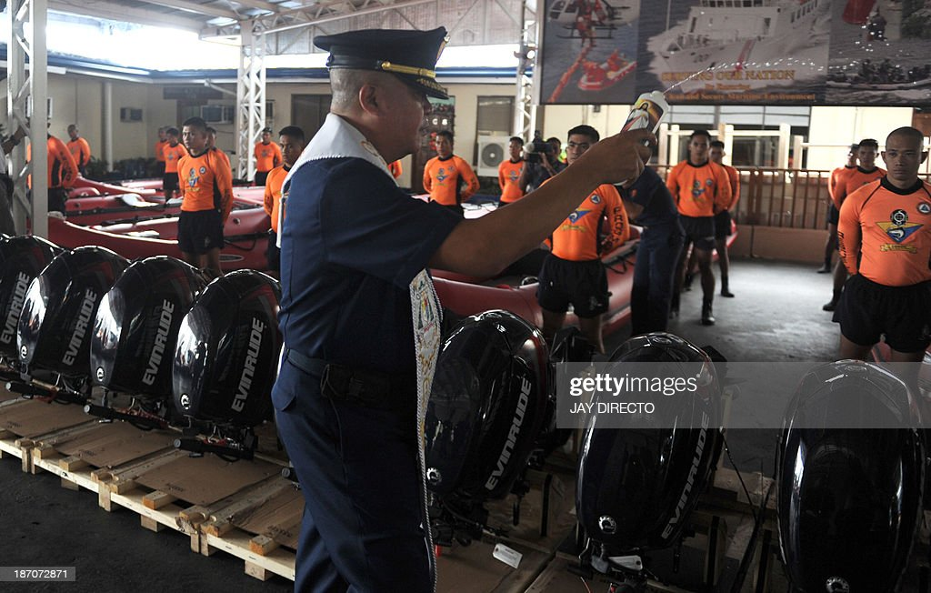 Philippine Coast Guard (PCG) Chaplain blesses newly-acquired rubber boats during a ceremony in Manila on November 6, 2013. PCG Chief Rear Admiral Rodolfo Isorena ordered the newly-acquired rubber boats to be deployed to the central Philippines in preparation for the super typhoon Haiyan which is expected to make a landfall in that area on November 8. The Philippines is preparing for what it believes will be the most powerful typhoon to hit this storm-ravaged country this year. AFP PHOTO / Jay DIRECTO