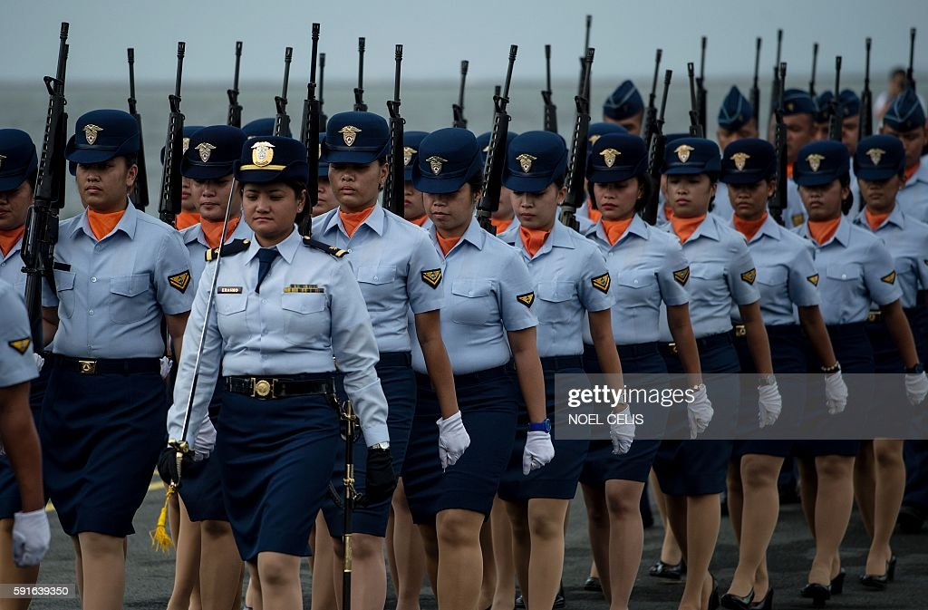 Philippine Coast Guard personnel march during the arrival ceremony of Philippine's first ever multirole response vessel called the BRP Tubbataha as...