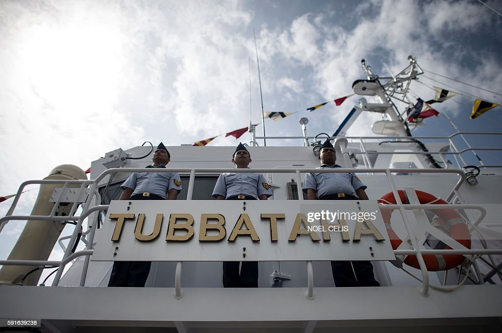 Philippine Coast Guard personnel stand in formation aboard Philippine's first ever multirole response vessel called the BRP Tubbataha as it arrives...